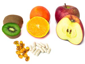 fruits-and-pills-on-white