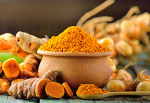 turmeric-roots-on-wooden-table